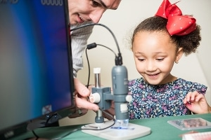 Young girl being taught science